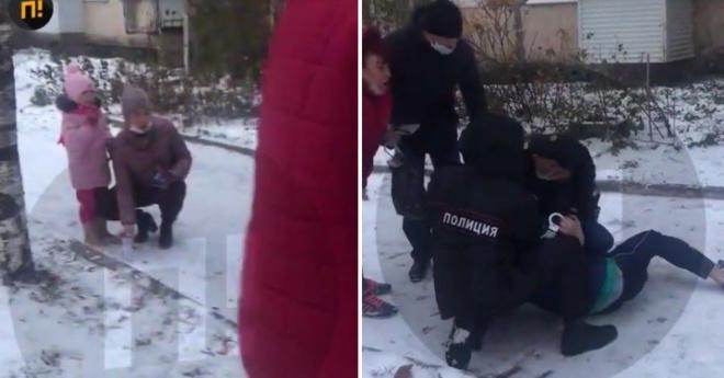 Полицейские на глазах плачущей дочки скрутили отца за отсутствия маски